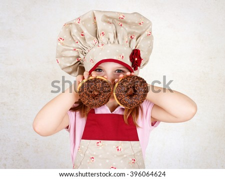 Young girl eating donuts - stock photo