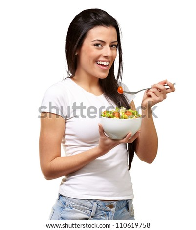 Young Girl Eating Salad From Bowl Isolated On White Background