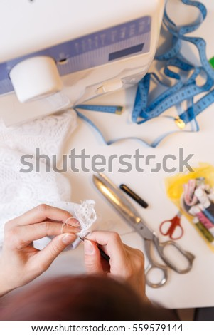 Young girl engaged in needlework