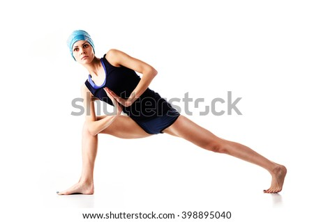 Young girl engaged in yoga, gymnastics, fitness. Lunge and twist