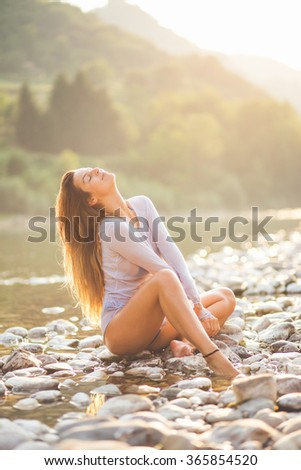 Young girl enjoy the magic of sun on beach - stock photo