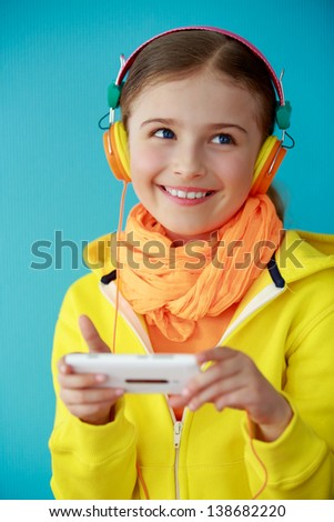 Young girl enjoying music - stock photo