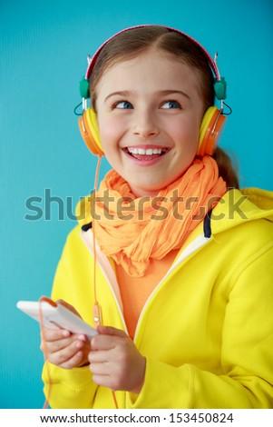 Young girl enjoying music - stock photo