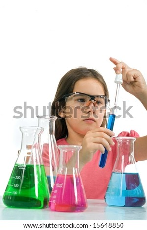 young girl examining a test tube in a science class