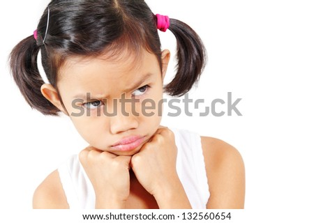 Young girl expressing emotion of anger.Isolated in white background. - stock photo