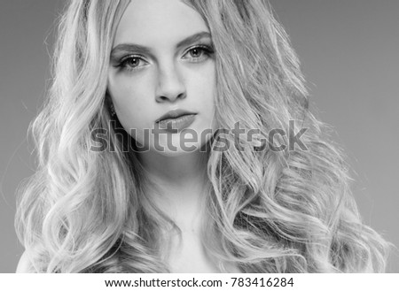 Young girl face beauty skin portrait with long blonde hair black and white