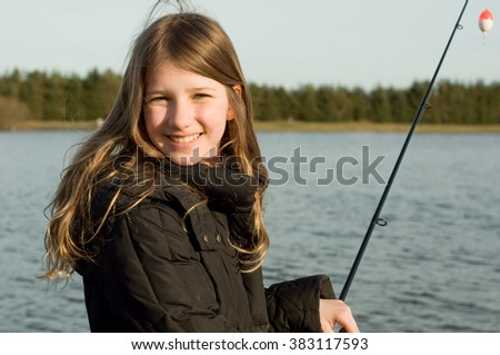 Young girl fishing on trout