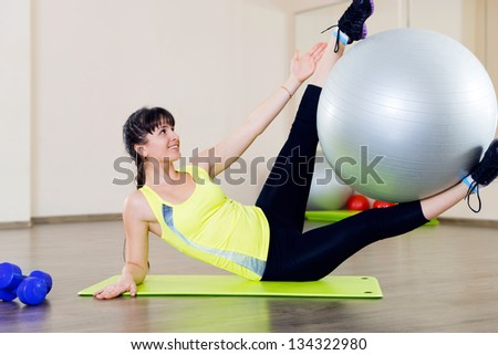 Young girl fitness workout in gym with fitball - stock photo