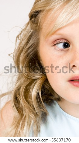 Young girl gets distracted - stock photo