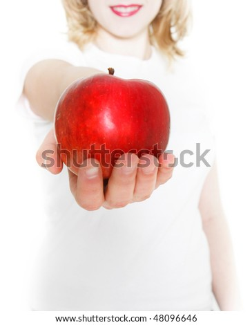 young girl giving red apple over white