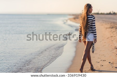 young girl going away on sea background - stock photo