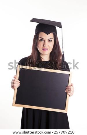 Young girl graduation with blackboard - stock photo