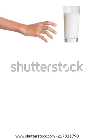 Young girl hand with a glass of milk