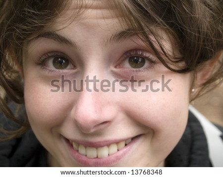 Young girl, happy face. Brown eyes and beautiful smile.