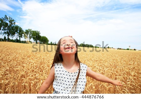 Young girl have fun in the wheat field