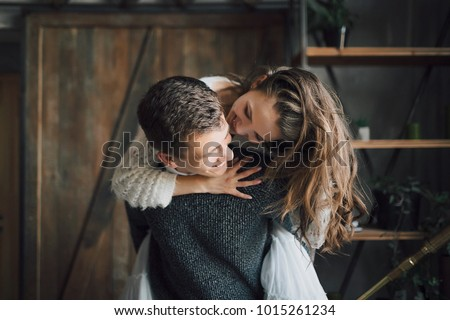 Young girl having a ride on her boyfriend's back. Artwork. Close-up. Selective, soft focus