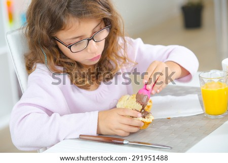 Young girl having a snack - stock photo