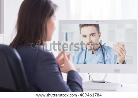 Young girl having an online consultation with her doctor - stock photo