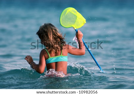 young girl having fun in the water