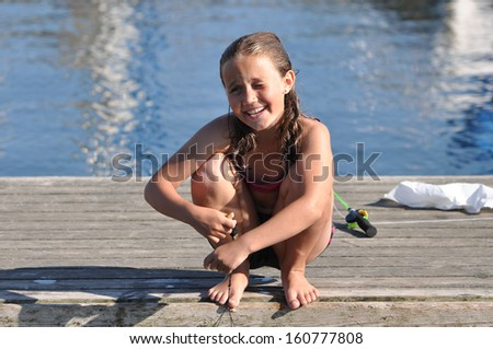 Young girl having fun on a landing stage near Malmoe, Sweden - stock photo