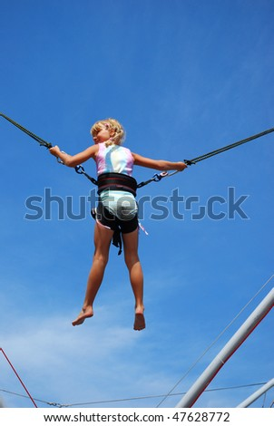 young girl having fun  on rope jumping - stock photo