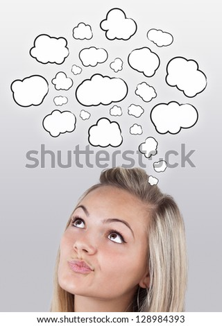 Young girl head thinking about white clouds