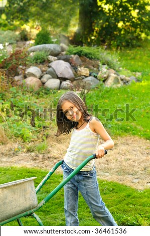 Young girl helping in the garden
