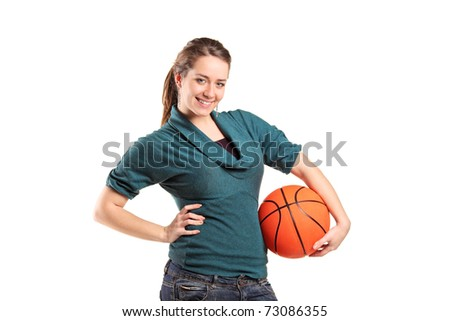 Young girl holding a basketball isolated on white background - stock photo