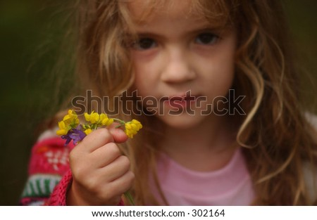 Young girl holding a bunch of flowers,