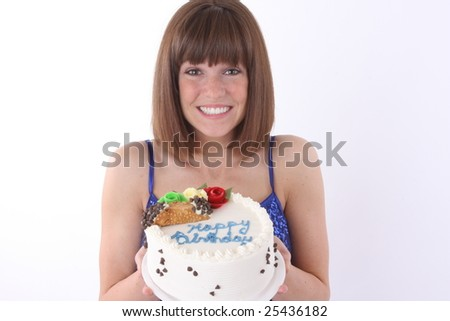 young girl holding a cake