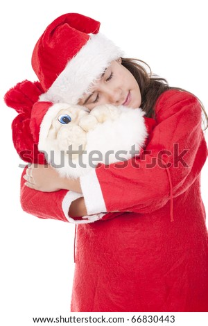 young girl holding a christmas bag and dreaming