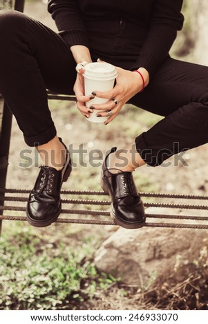 young girl holding a cup of coffee - stock photo
