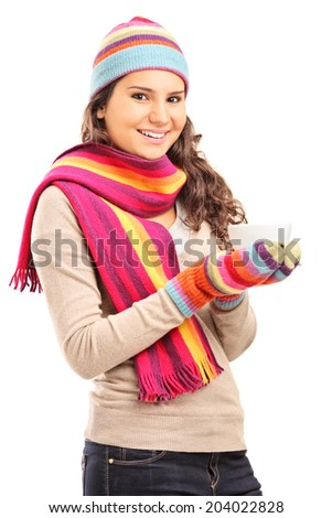 Young girl holding a cup of hot tea isolated on white background - stock photo