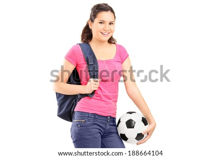 Young girl holding a football isolated on white background