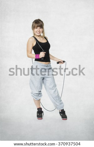 young girl holding a jump rope - stock photo