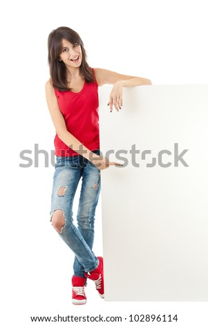 Young girl holding a long vertical white banner over a white background - stock photo