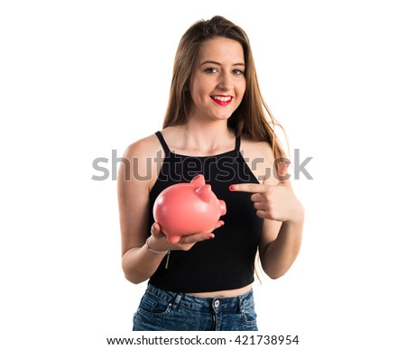 Young girl holding a piggybank - stock photo
