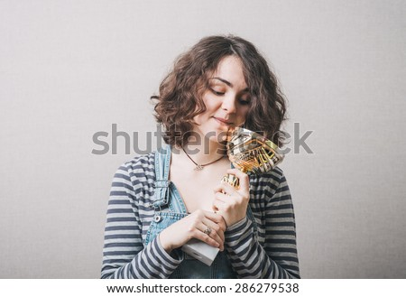 young girl holding a prize cup and happy - stock photo