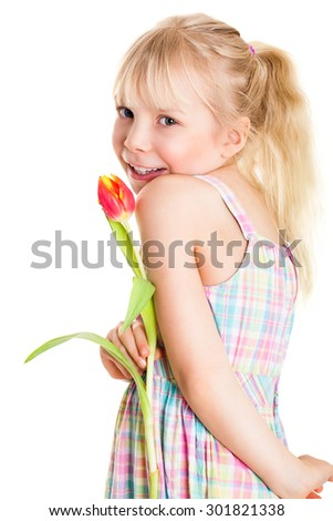 young girl holding a tulip in front of isolated background