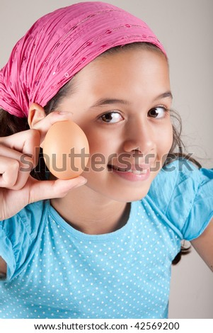 Young girl holding an egg - stock photo