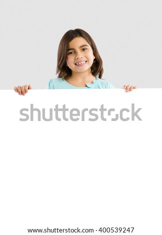 Young girl holding and showing something on a whiteboard