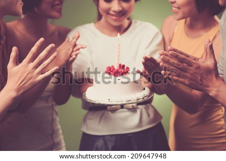 Young girl holding birthday cake - stock photo