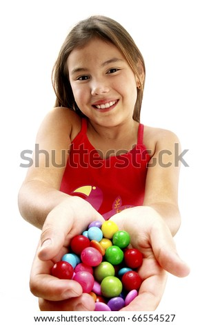 Young girl holding candies. - stock photo