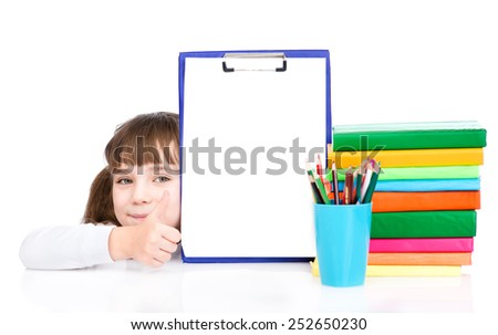 young girl holding clipboard with an empty document and showing  - stock photo