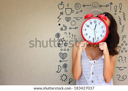 young girl holding clock in front of face, doodles as thoughts and room for text.