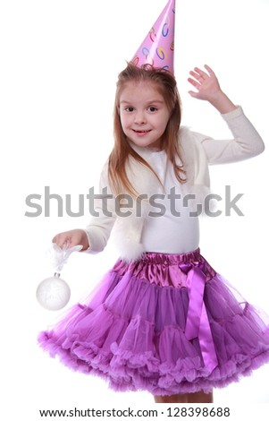 Young girl holding decorative white ball