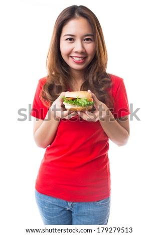 Young girl holding hamburger on white background