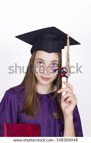 Young girl holding her diploma. Young girl holding her diploma with pride looking at copy space. Isolated over white background. - stock photo