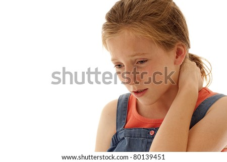 young girl holding her neck in pain