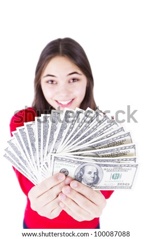 Young girl holding her paycheck, all one hundred dollar banknotes, asking what would you do with all this money, All one hundreds. Isolated on white background.